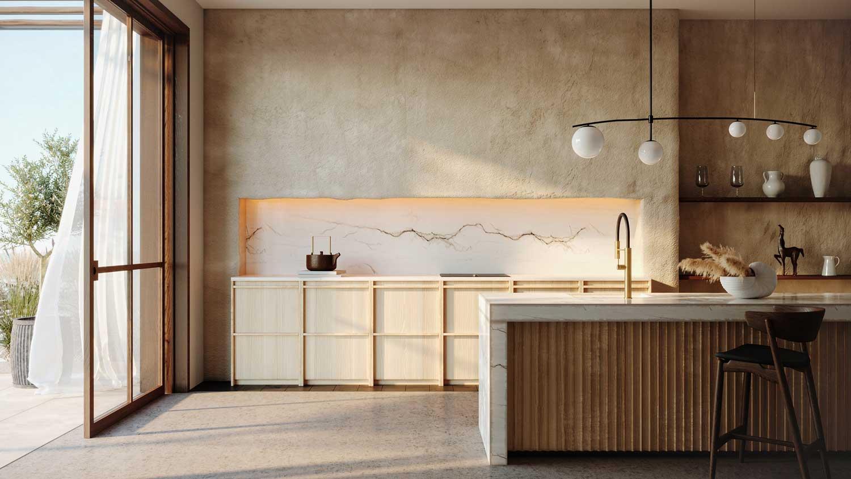 Une cuisine qui mélange tadelakt, marbre et bois pour un intérieur agréable et chaleureux