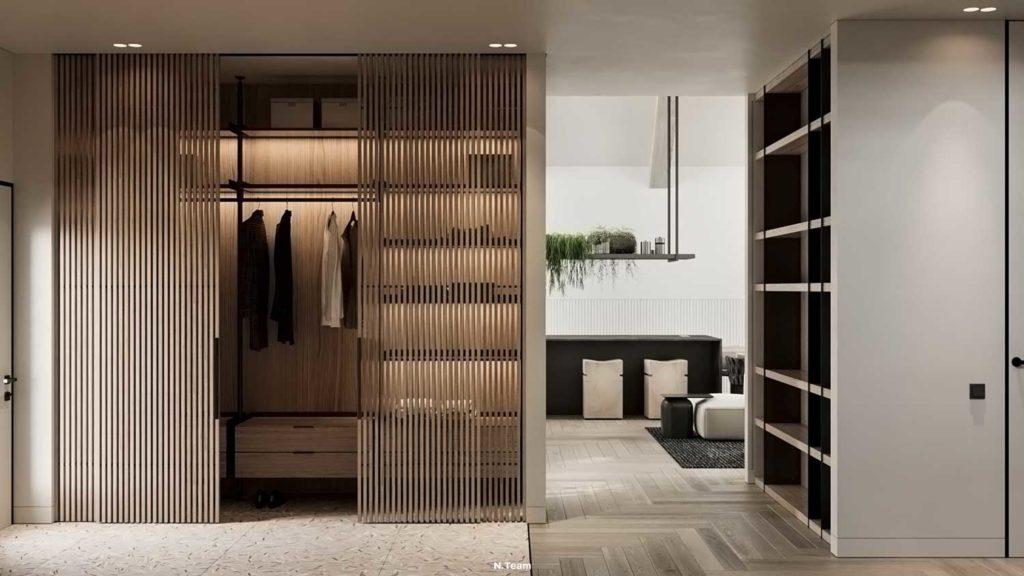 Un dressing en bois aux portes en claire-voie dans une entrée