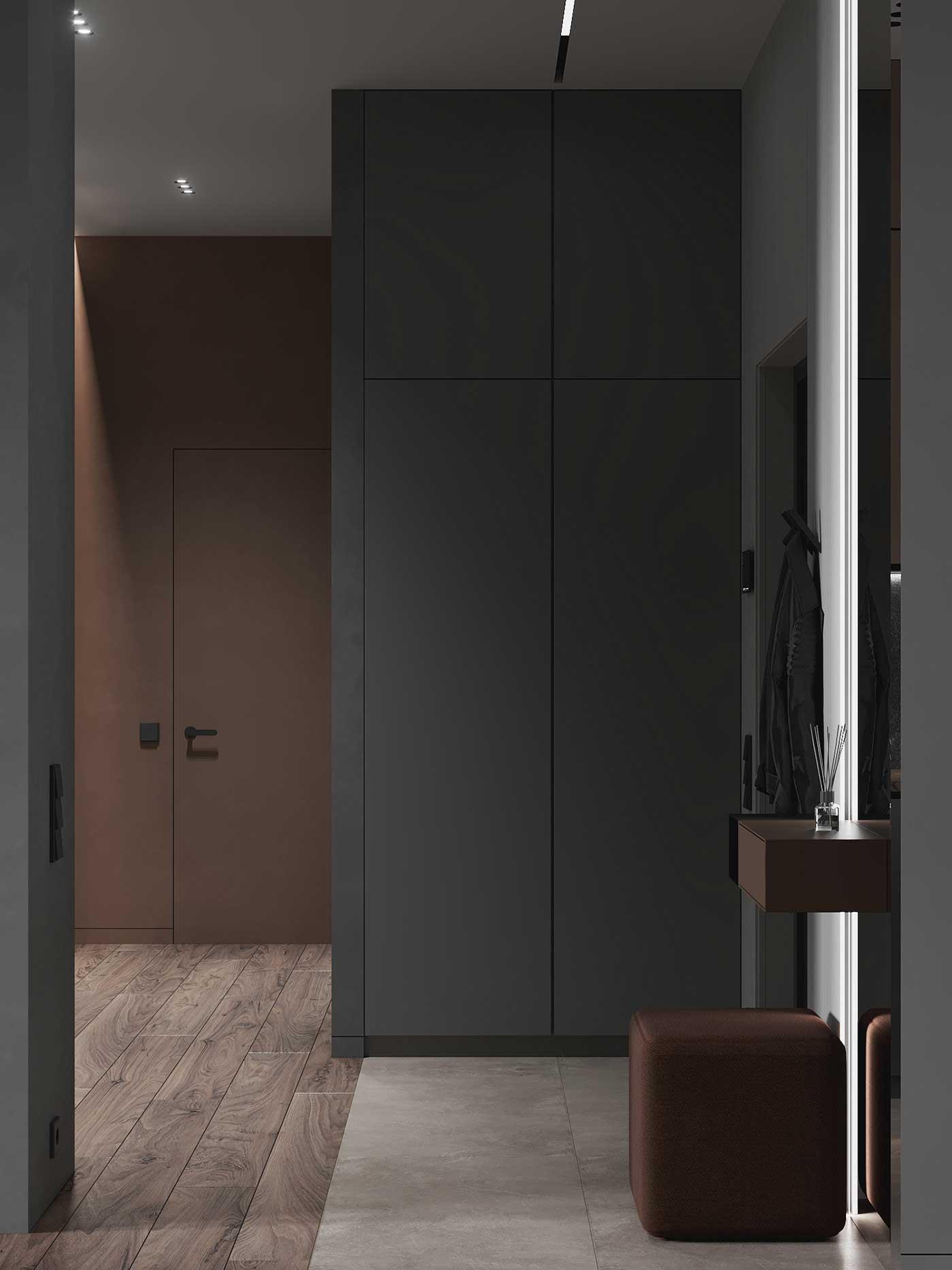 Une entrée minimaliste noir et brun avec un tabouret carré en cuir