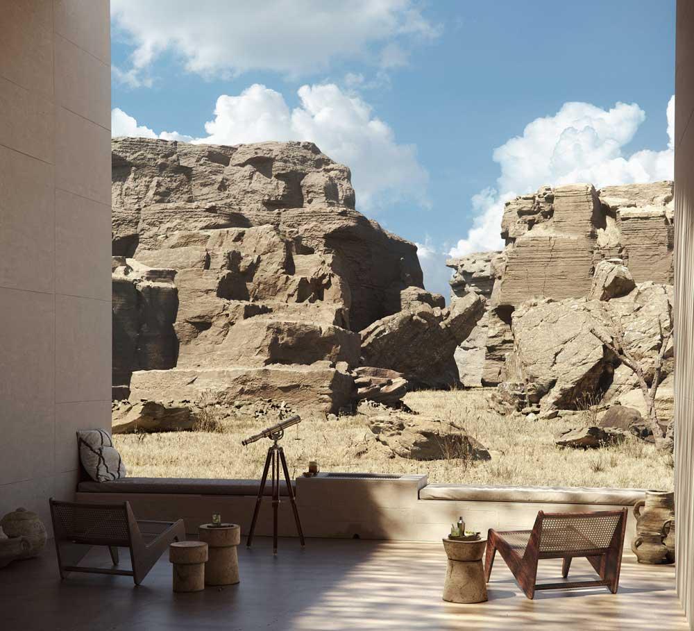 Le mobilier de jardin forme un coin détente et observation avec des fauteuils tendance en bois et cannage