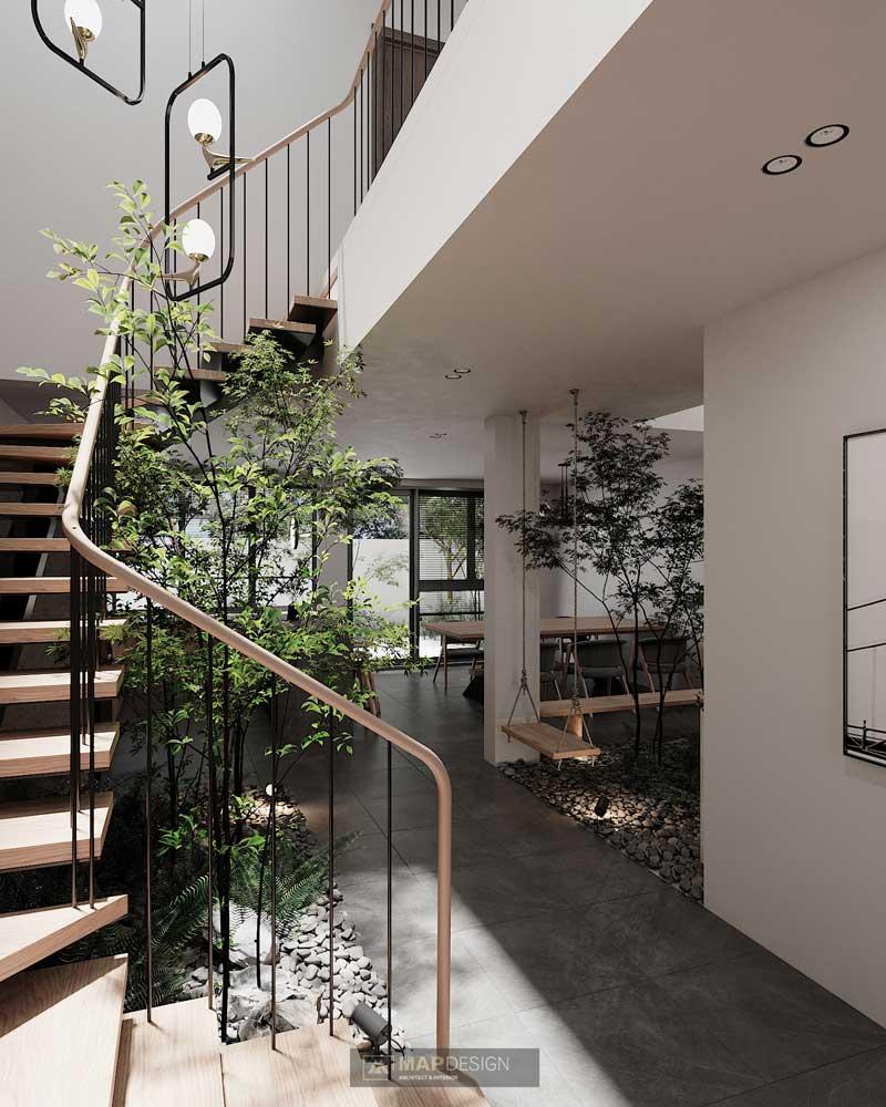 Des arbres d'intérieur aux branches frêles apportent un côté zen et délicat à un intérieur aux coloris sobres