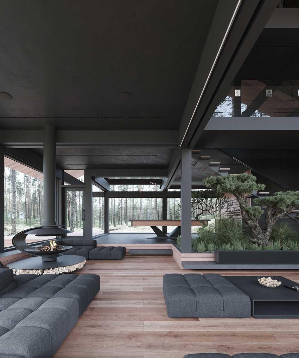 Un jardin zen d'intérieur dans un grand intérieur moderne en noir et en bois