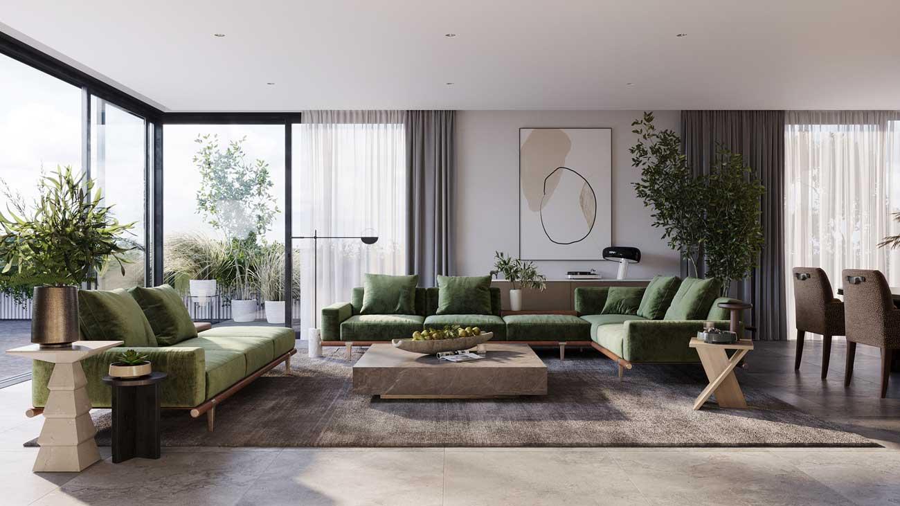 Un grand salon doté de plantes et d'arbres d'intérieur qui amènent la végétation du jardin à l'intérieur