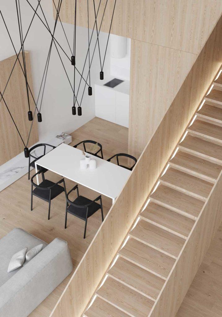 Une salle à manger design avec des suspensions lumineuses noires et un grand escalier rétroéclairé en bois blond