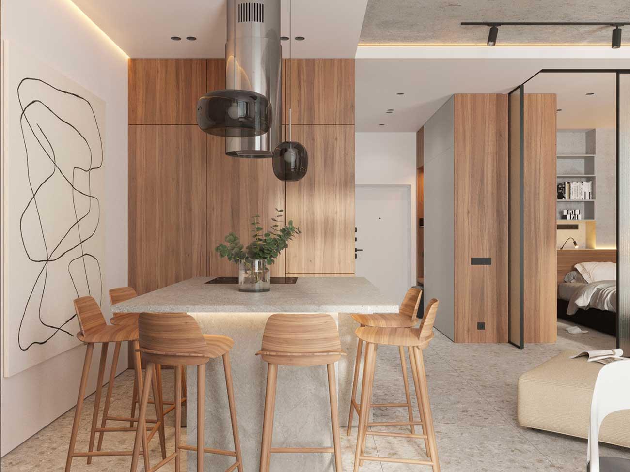 Un coin cuisine minimaliste où les rangements se cachent dans des lacards en bois blond accordés aux tabourets hauts