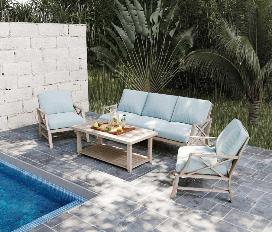 Un petit salon outdoor blue sky au bord d'une piscine pour profiter du jardin
