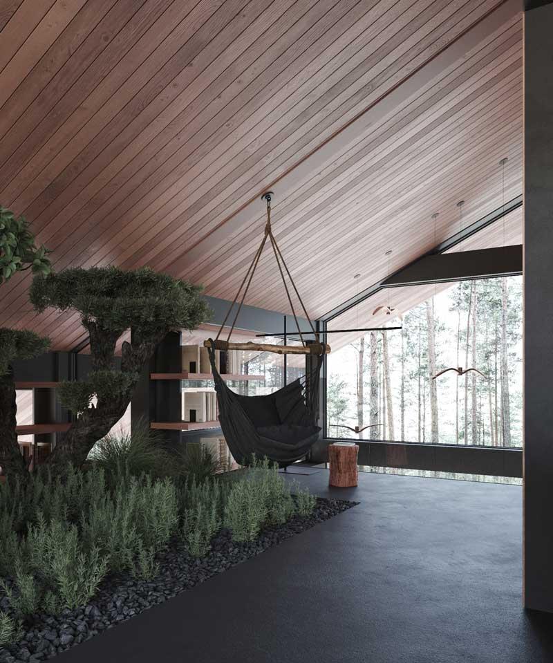Sous un plafond mansardé en bardage en bois, des arbres d'intérieur forment un petit jardin zen pour un espace détente