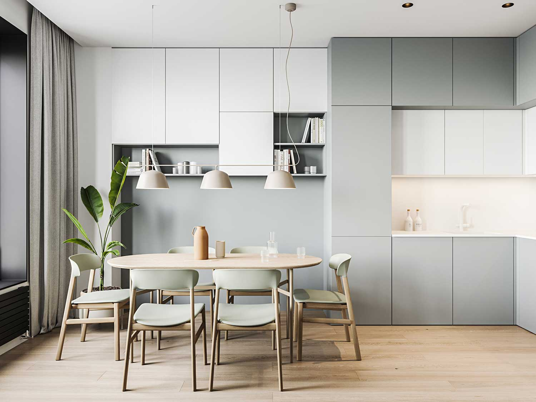 Une salle à manger aux tons pastels avec un petit espace cuisine