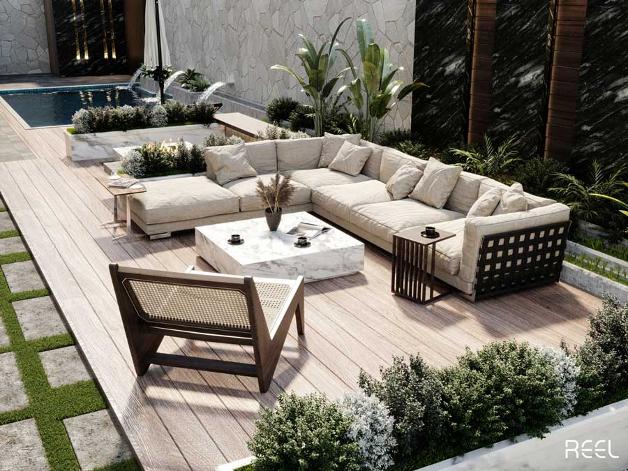 Un grand salon de jardin avec fauteuil et canapé sur une terrasse en bois blond près de la piscine