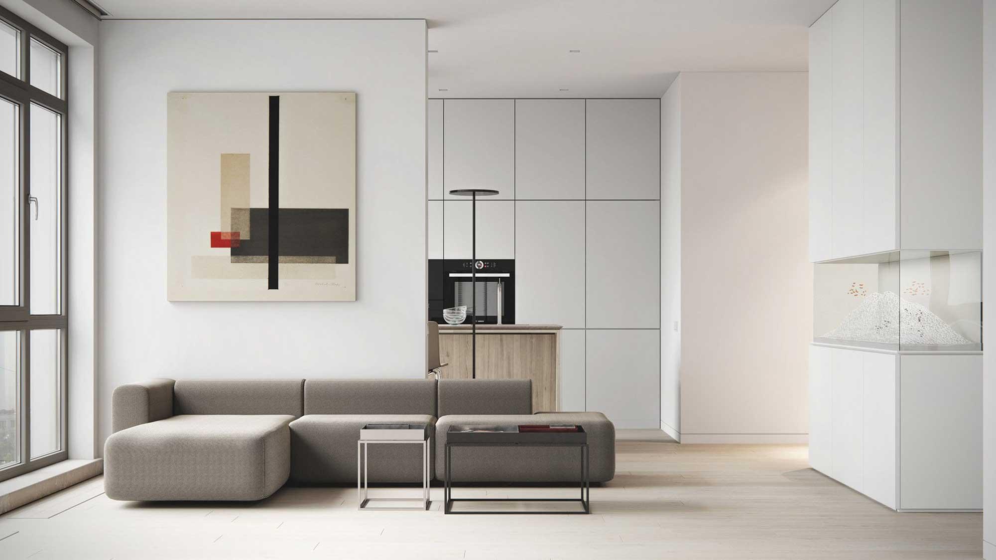 Un salon blanc minimaliste avec une pointe de décoration et un aquarium incrusta dans le mur