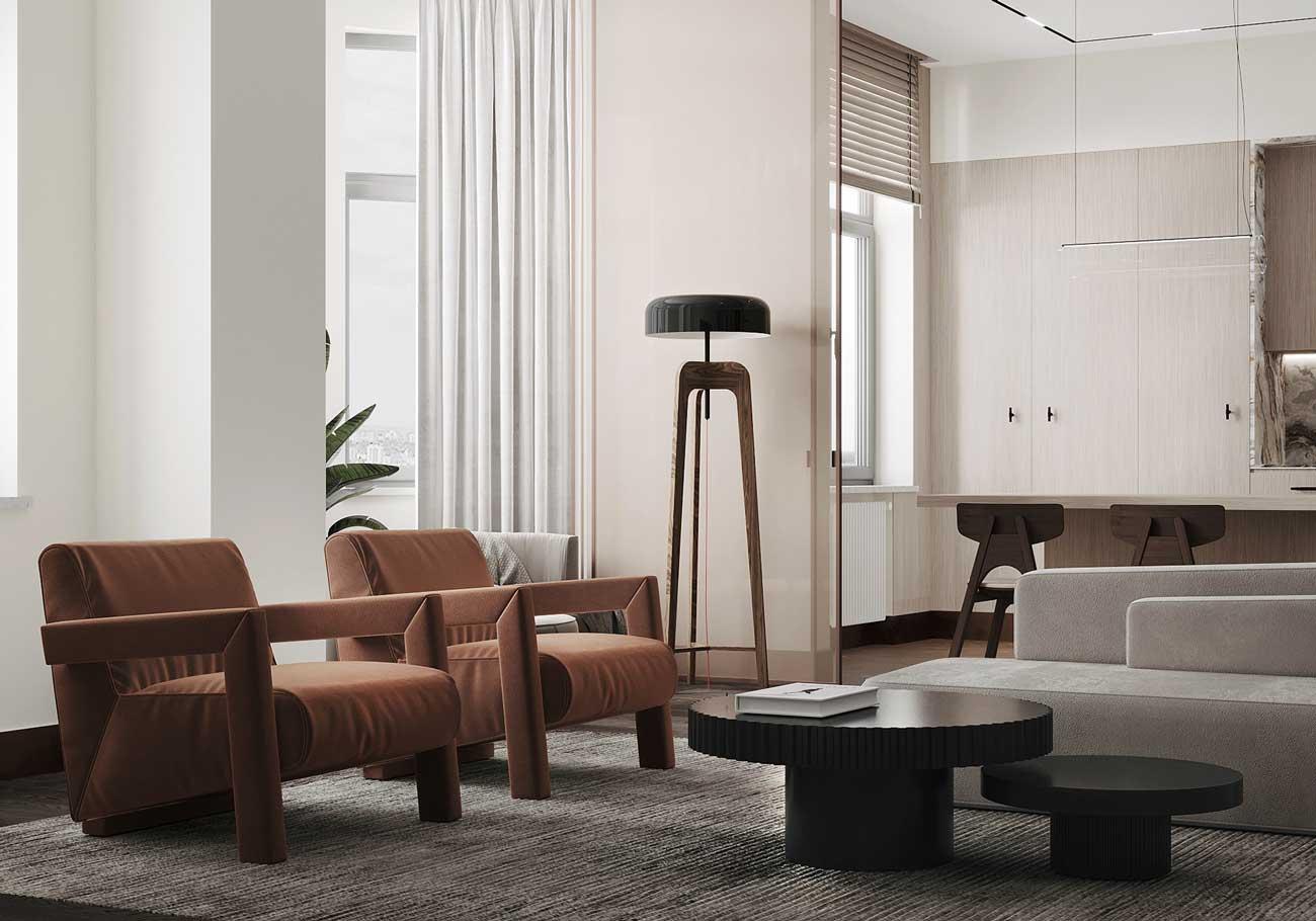 Des touches de déco et de couleur dans un salon minimaliste avec des fauteuils marrons et des tables basses rondes aux bords crénelés