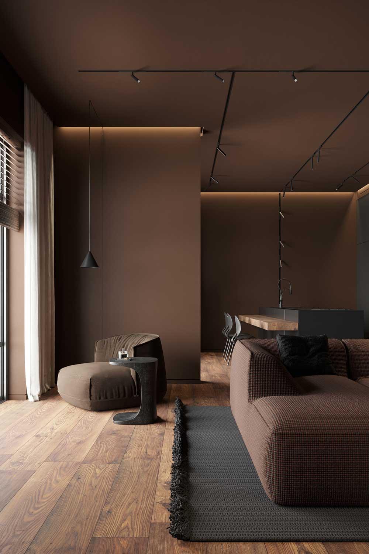 Un salon minimaliste marron où les assises sont de la même couleur que les murs et se fondent dans le décor