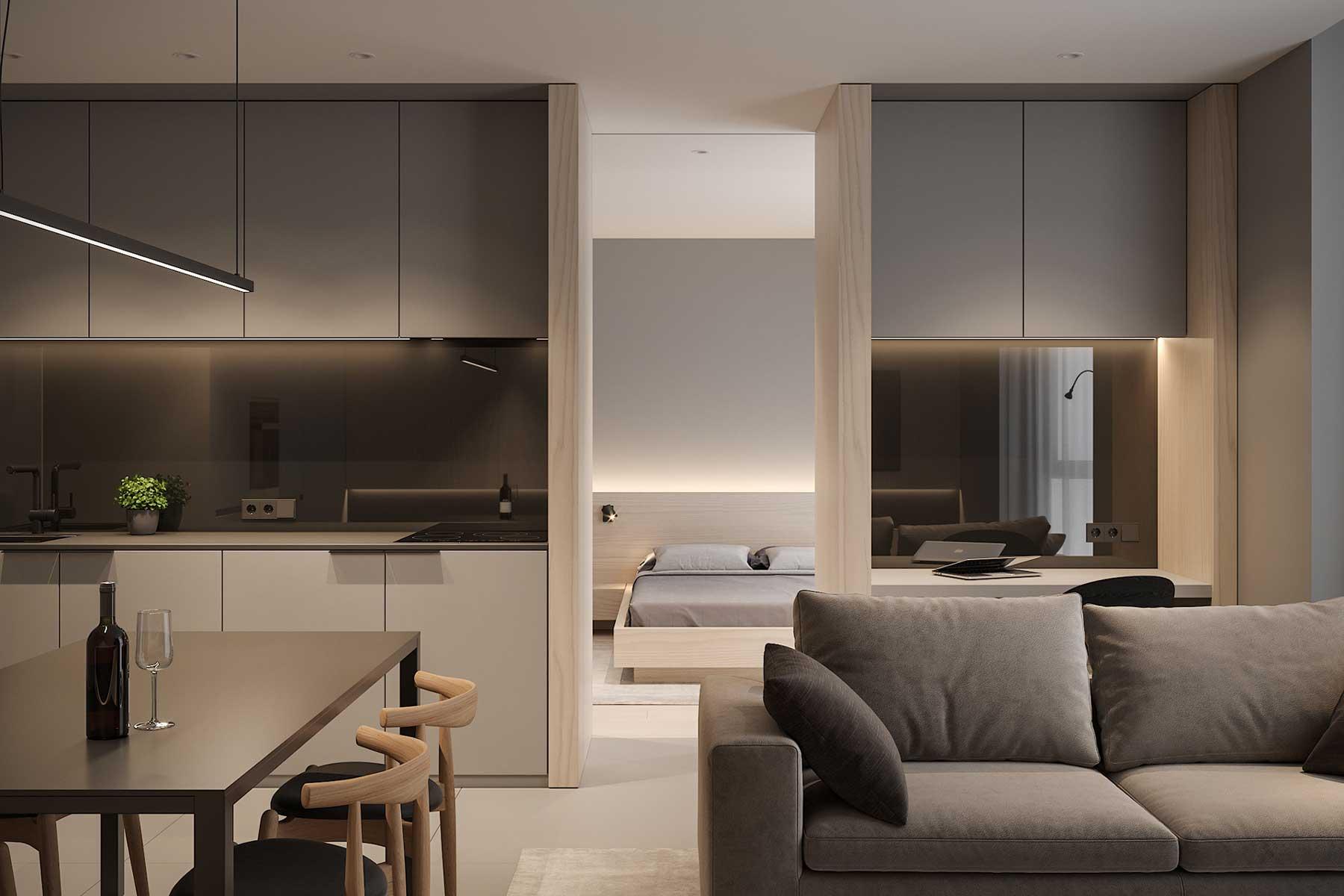 Un studio fonctionnel où un coin bureau sert de séparateur entre la salle de séjour et la chambre