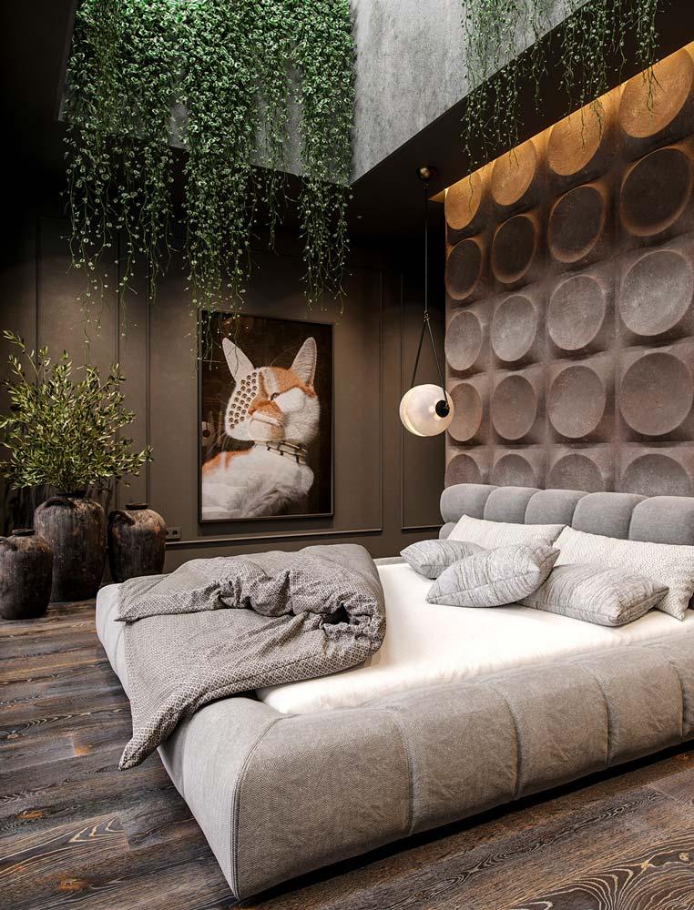 Une chambre masculine avec une tête de lit en béton à motif