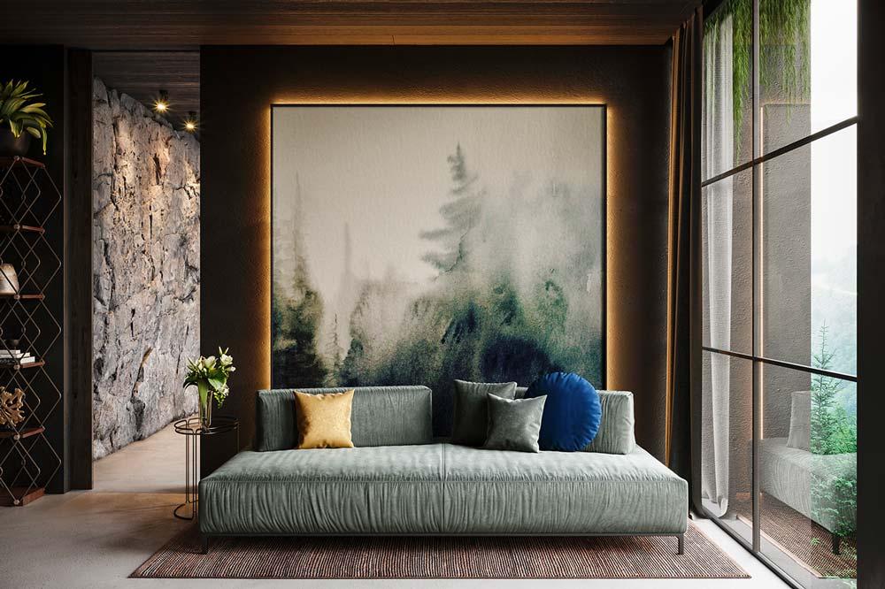 Un refuge masculin avec un sofa vert sauge et un mur en pierre naturelle