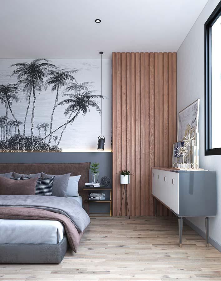 Une tête de lit noire et blanche représentant une ile des tropiques