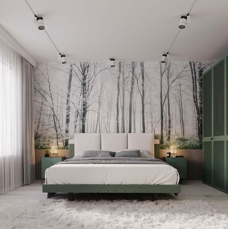Une tête de lit panoramique à l'effigie d'une forêt enneigée