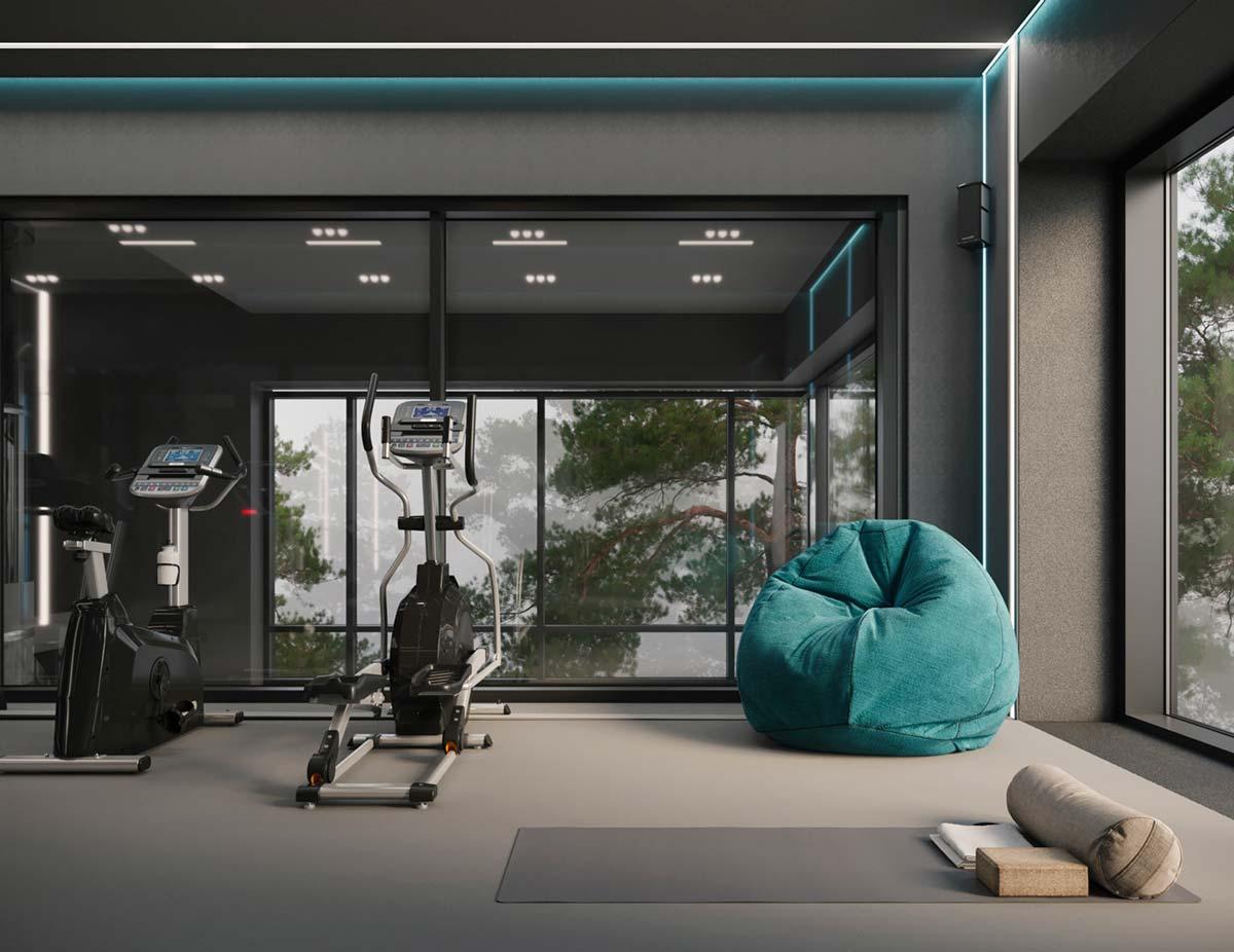 Une salle de sport grise chez soi baignée de lumière