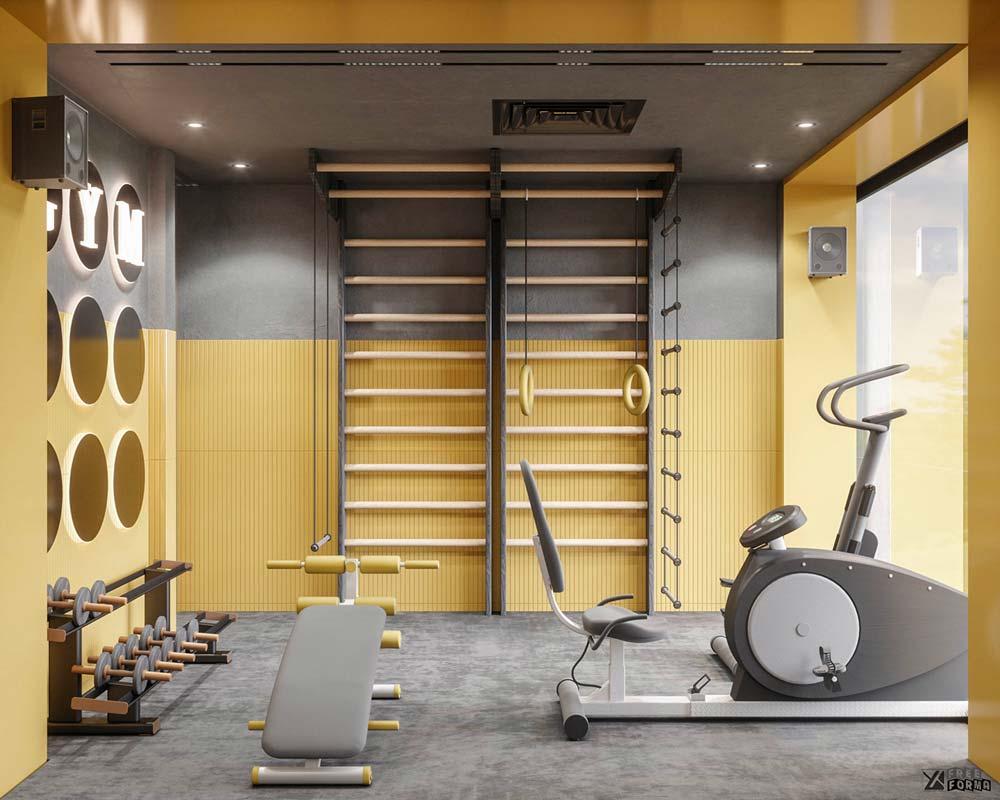 Une salle de sport dans une chambre aux couleurs grises et jaunes