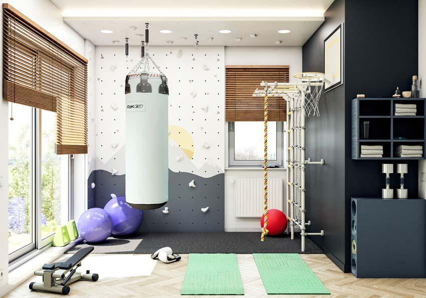 Une salle de sport dans une chambre colorée et ludique