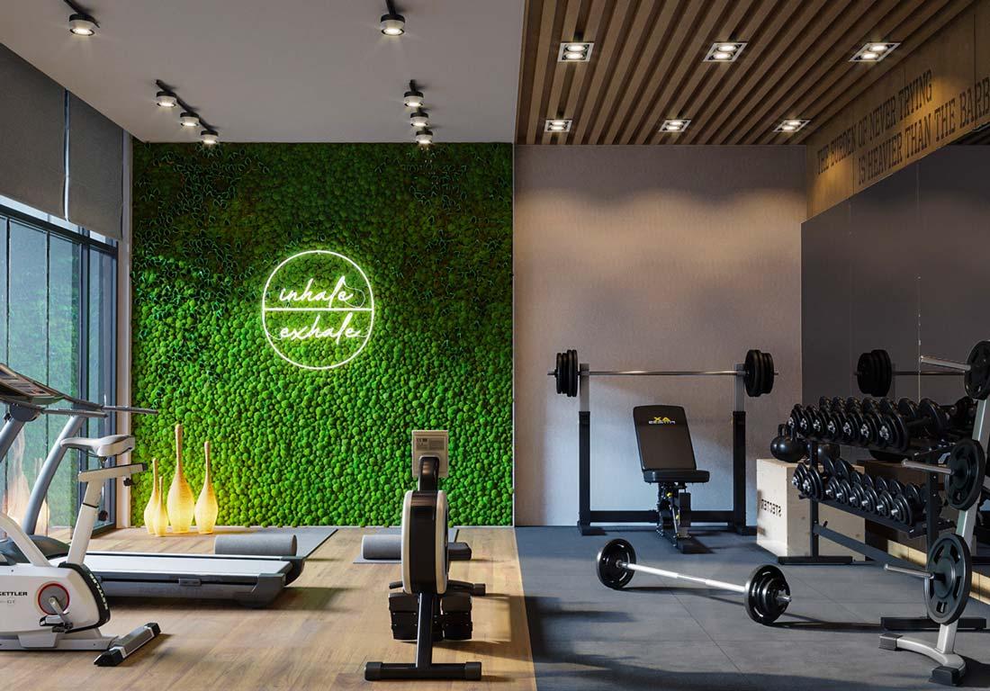Une salle de sport à domicile chaleureuse avec un mur végétal