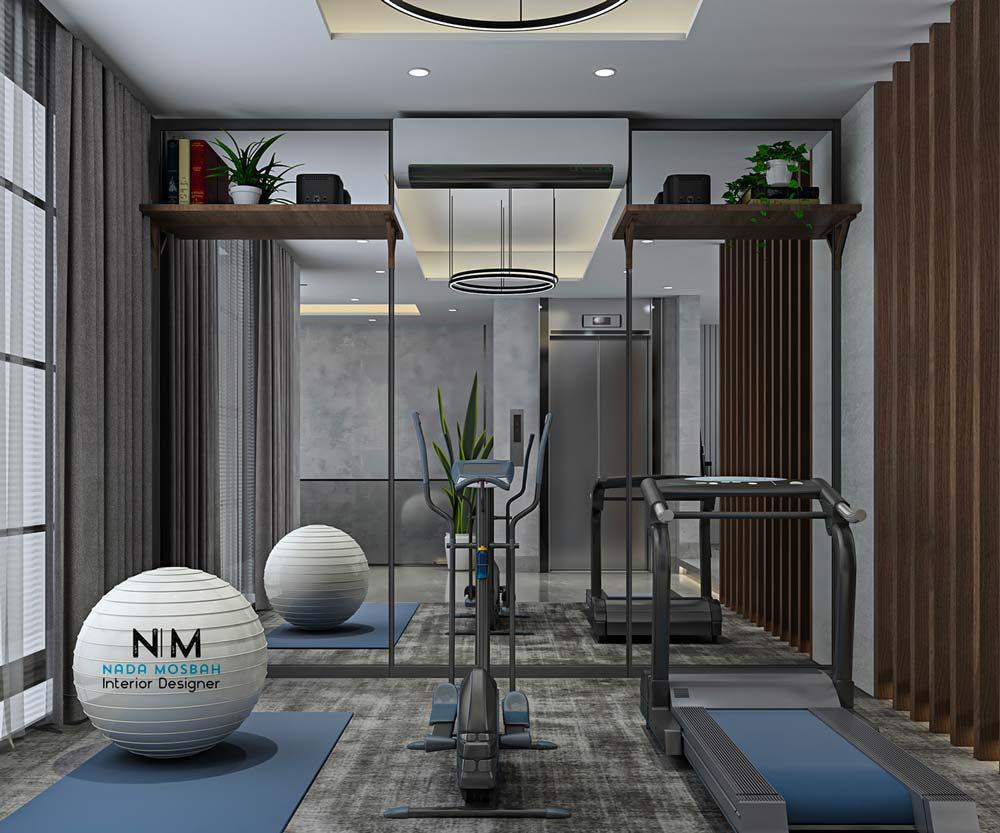 Une salle de sport aménagée dans une chambre non occupée d'un appartement