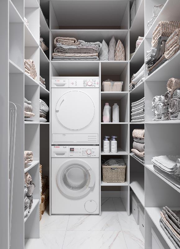 Une buanderie blanche en U optimisée avec un lave-linge et un sèche linge