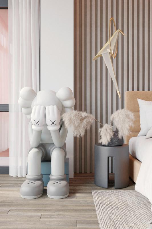 Une chambre girly et pastel avec un art toys tendance : separated de Kaws
