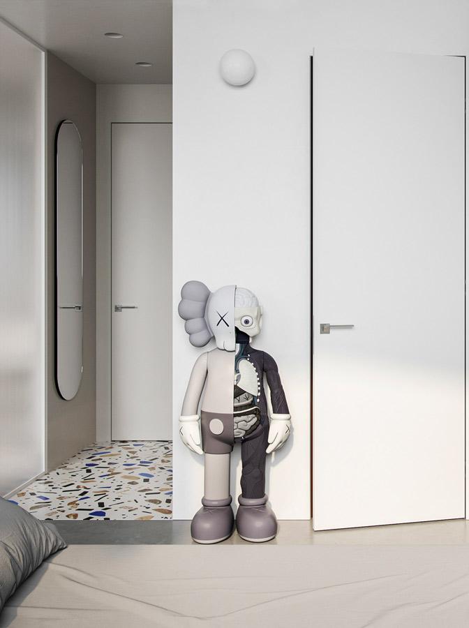 Un studio minimaliste blanc décoré d'un art toys dissected