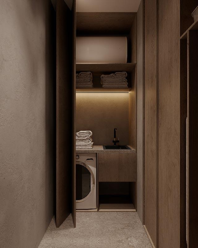 Une petite buanderie d'appartement en bois dans un placard avec un évier