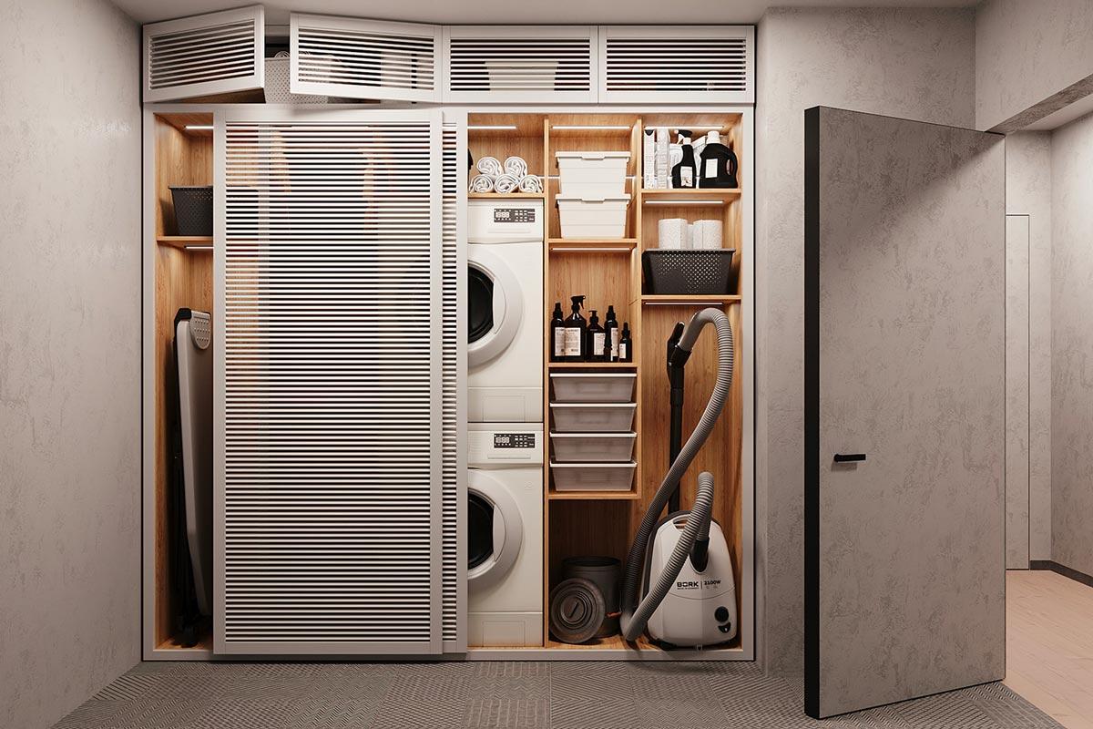 Une buanderie dans un cellier avec des portes persiennes blanches coulissantes