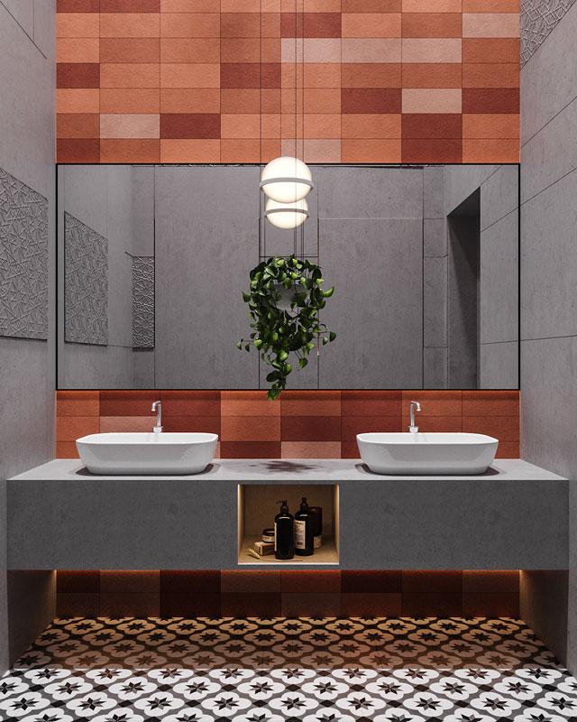 Une salle de bain de couleur terracotta et des carreaux de ciment
