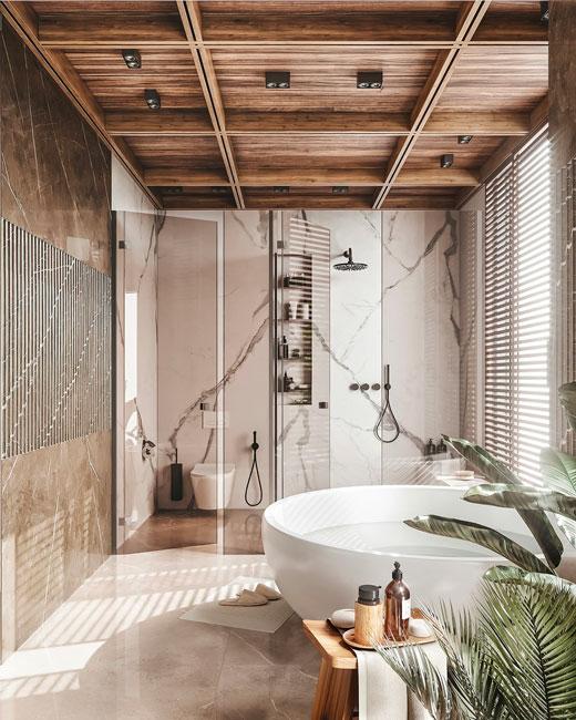 Une salle de bain à l'esprit d'un spa luxueux avec une baignoire ronde en îlot et du marbre