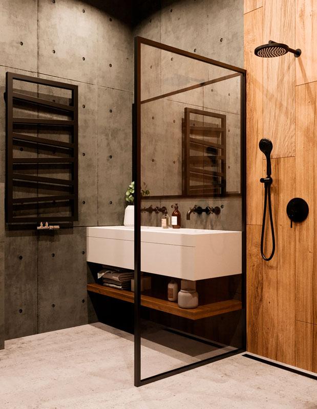 Une salle de bain industrielle avec du béton banché et du carrelage imitation bois