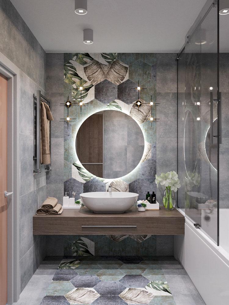 Une salle de bain grise avec un carrelage végétal et un meuble en bois